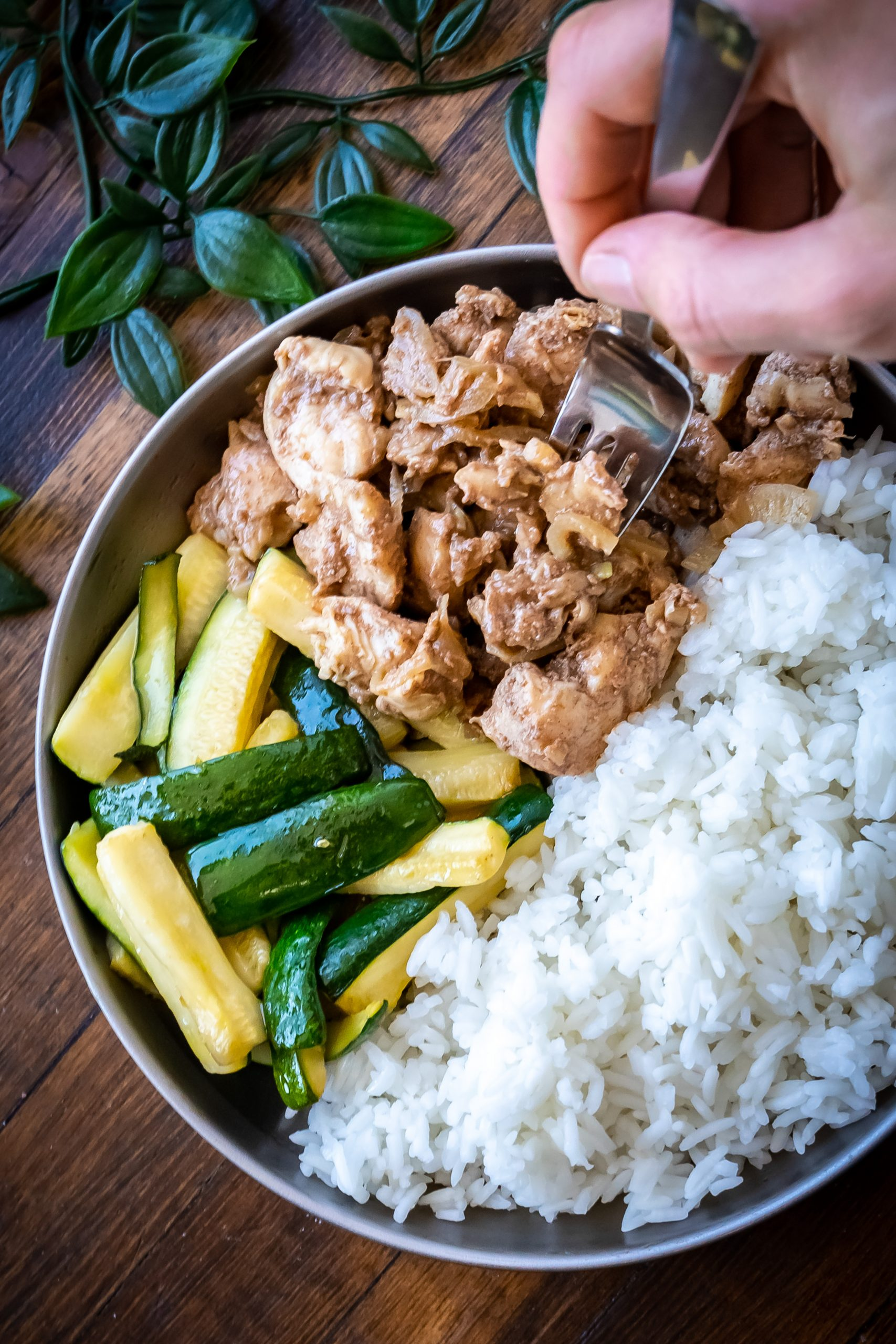 Enjoying Chinese Five Spice Chicken with zucchini spears and fluffy rice