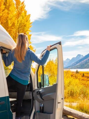 Camper van and camper looking through Aspen at the Grand Tetons