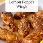 Air Fryer Lemon Pepper Wings ready for serving with glaze and fresh zest.