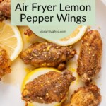 Overhead view of Air Fryer Lemon Pepper Wings ready for serving with glaze and fresh zest and lemon slices.