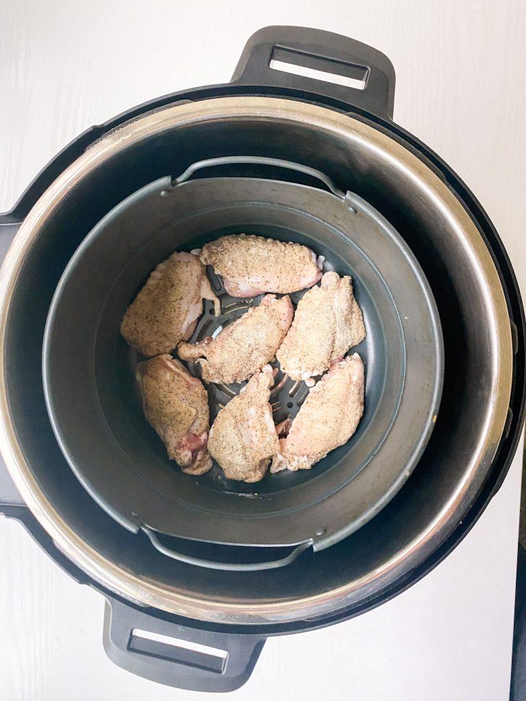7 Lemon Pepper wings arranged in an air fryer basket, skin-side up.