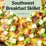 Overhead view of the Southwest Breakfast Skillet with avocado and green onions on top.