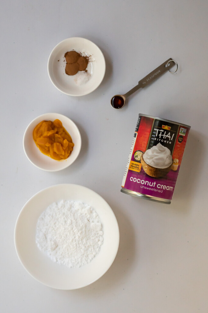 Overhead view of the six ingredients you need to make dairy-free pumpkin spice coconut whipped cream.