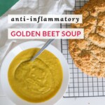 Overhead view of a bright golden bowl of pureed beet soup beside a fresh loaf of gluten-free Irish Soda Bread.